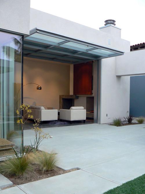 Living Room Garage Door Part - 18: Garage Door View In Gallery. Contemporary Living Room With Built In Shelf  Concrete Floors